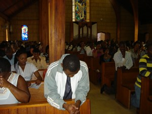people praying in church